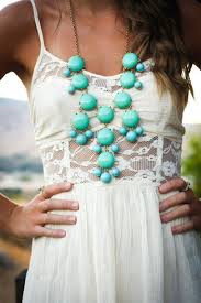 white summer dress and blue necklace